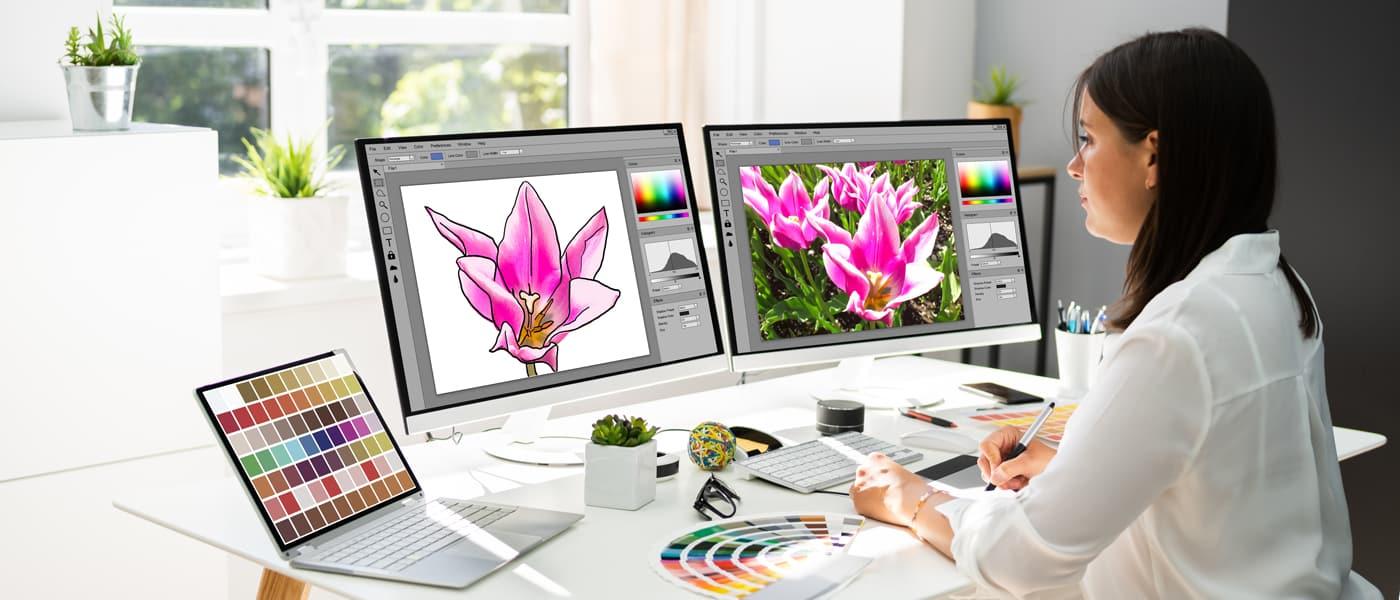 Woman making NFT Artwork on Laptop