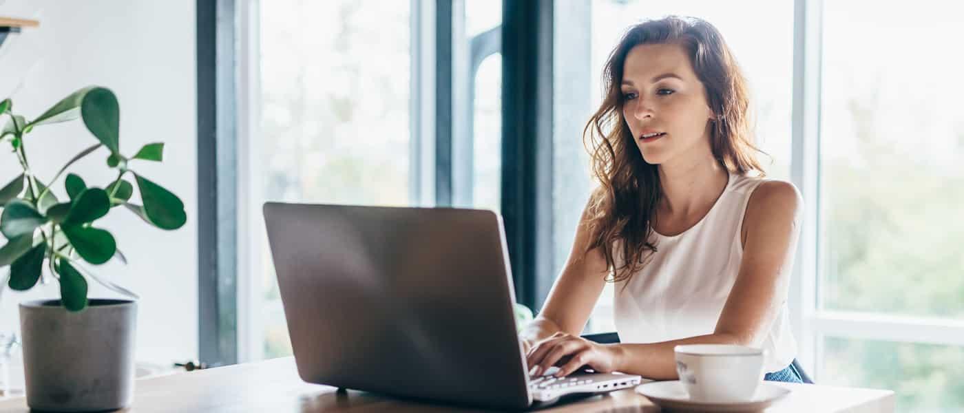 Woman buying NFT Artwork on laptop